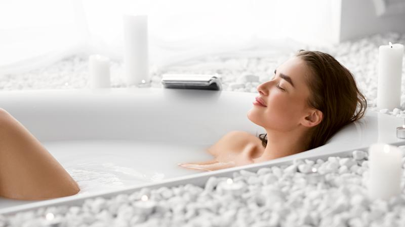 Wellness And Relax Concept. Woman Resting In Bath After Work Day