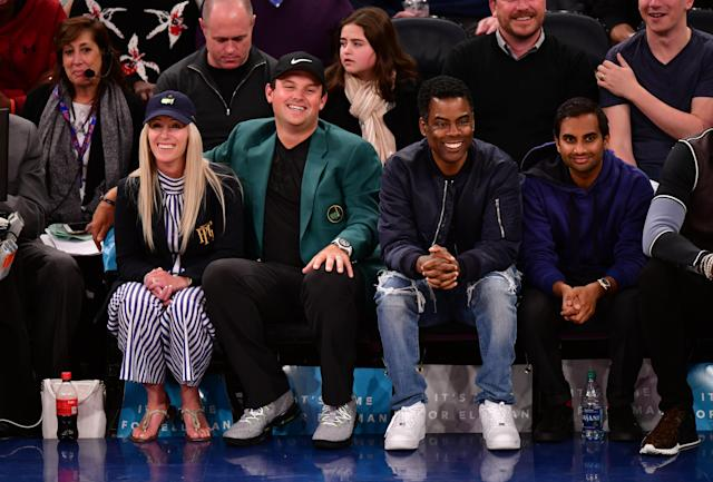 Chris Rock and Aziz Ansari were also seated near Masters winner Patrick Reed and his wife, Justine Reed, at the Knicks game on April 9. (Photo: James Devaney/Getty Images)