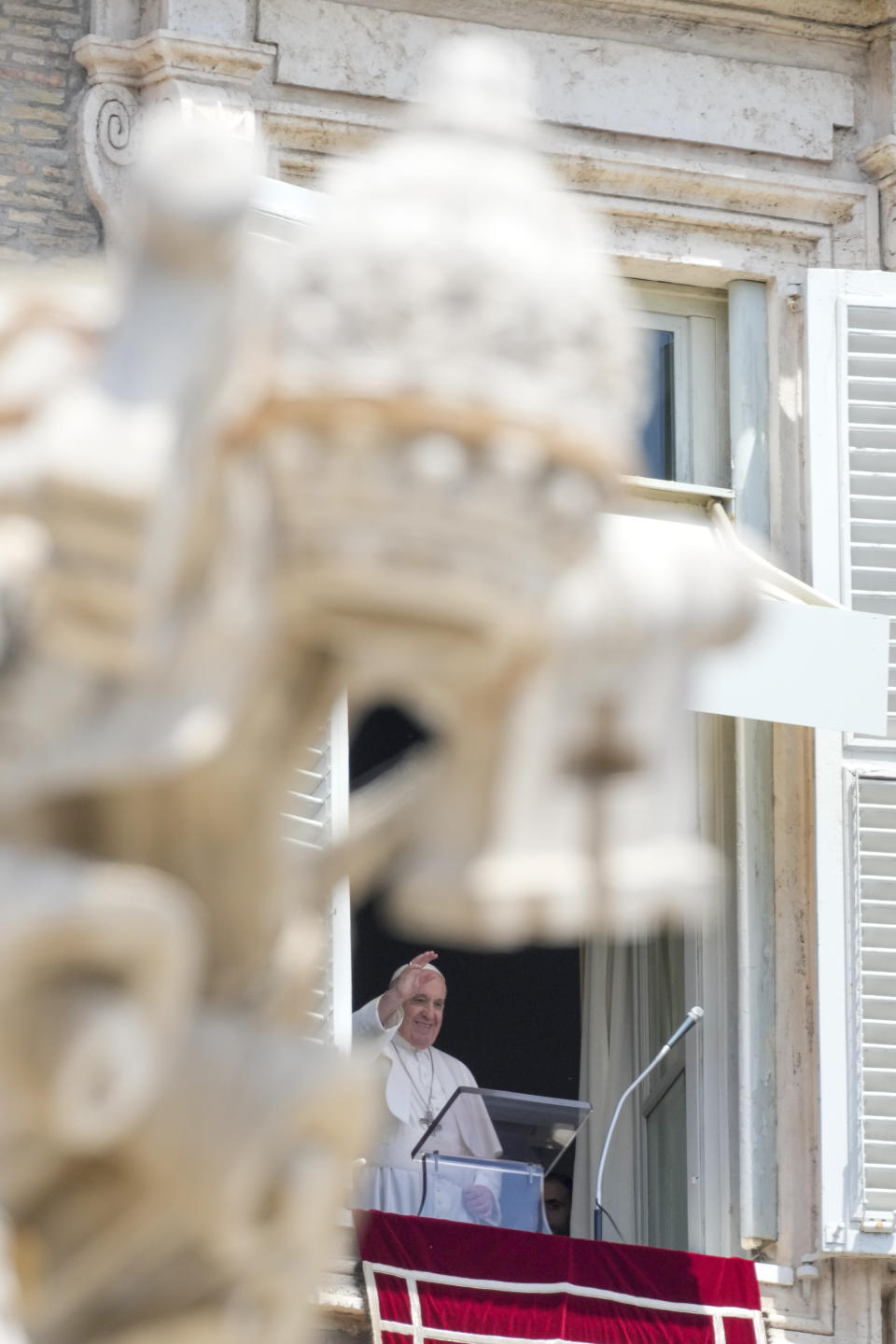 Pope Francis delivers his blessing during the Angelus noon prayer from the window of his studio overlooking St.Peter's Square, at the Vatican, Sunday, June 13, 2021. Francis demanded during his speech for humanitarian aid to reach residents of the war-torn Tigray region of northern Ethiopia, where Ethiopian and Eritrean soldiers are blocking food and other assistance. (AP Photo/Andrew Medichini)