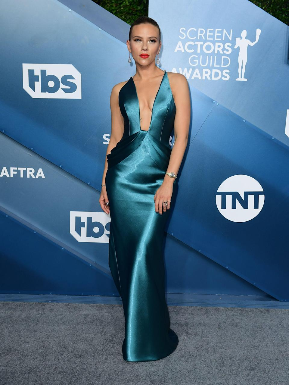 <h2>Scarlett Johansson in Armani Privé</h2><br><em>Marriage Story</em>'s Scarlett Johansson is a tall glass of water in this ocean blue, deep-V gown by Armani Privé.<br>