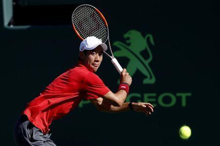 Mar 29, 2017; Miami, FL, USA; Kei Nishikori of Japan reaches for a backhand against Fabio Fognini of Italy (not pictured) on day nine of the 2017 Miami Open at Crandon Park Tennis Center. Fognini won 6-4, 6-2. Geoff Burke-USA TODAY Sports