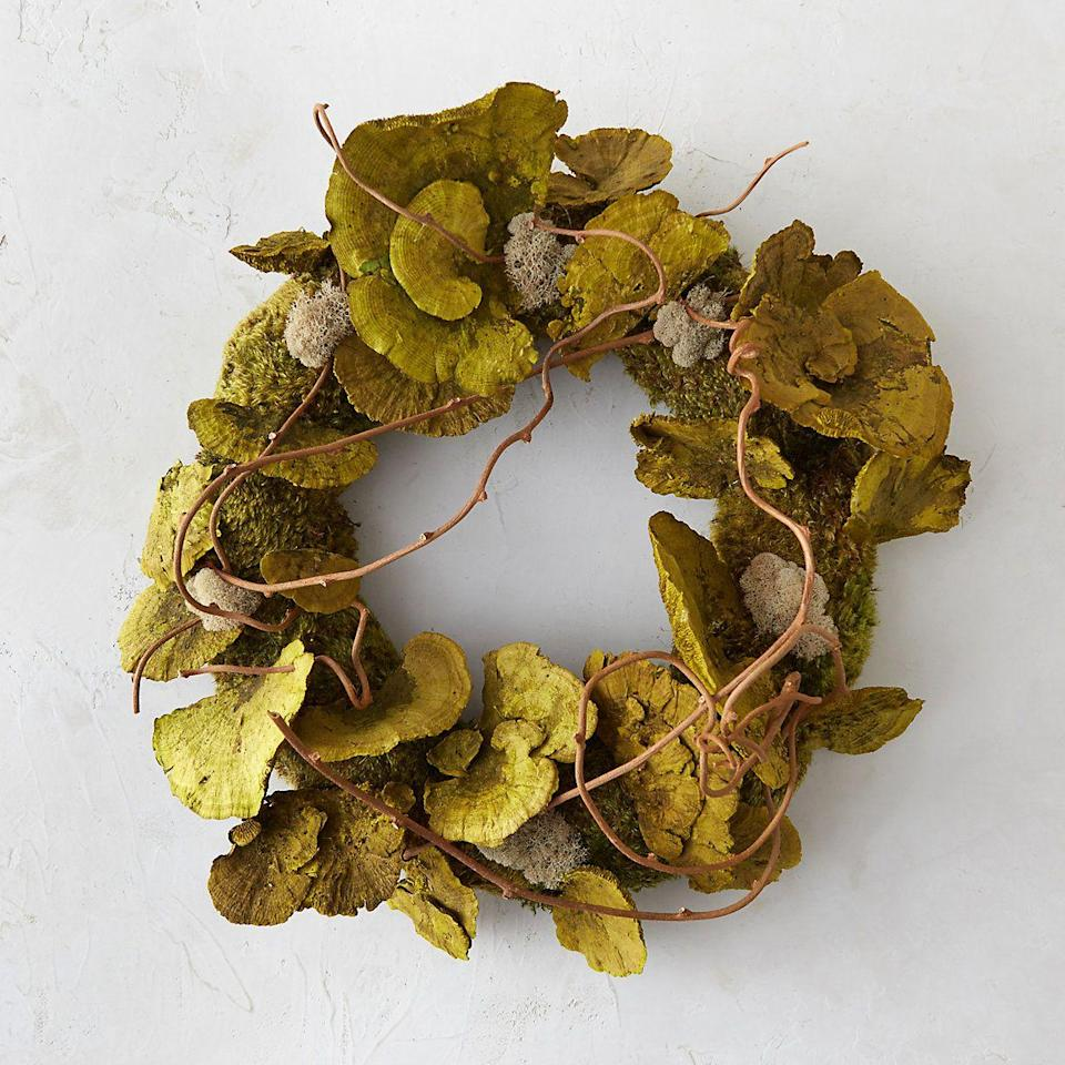 <p>This whimsical and woodsy wreath looks as if it came from fairy garden with preserved clump moss, reindeer moss, green sponge mushroom, and dried grapevine. </p>