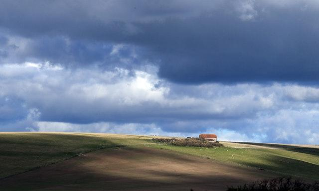 A view of farm buildings on the South Downs near Eastbourne in Sussex