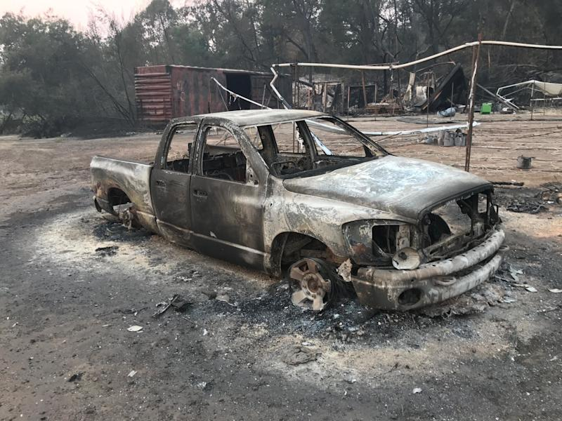 Thecharred remnants of a truck on Pearson's farm.