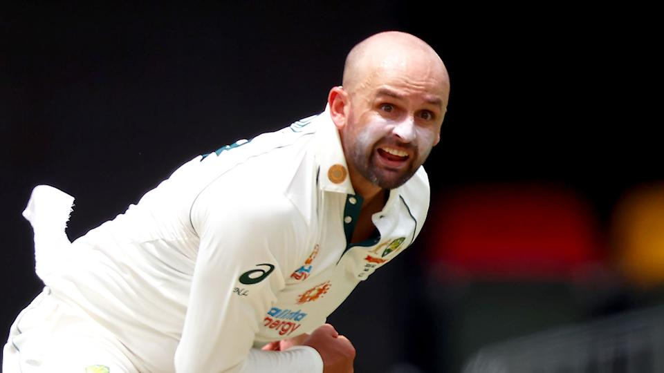 Pictured here, Nathan Lyon delivers a ball in a Test match for Australia.