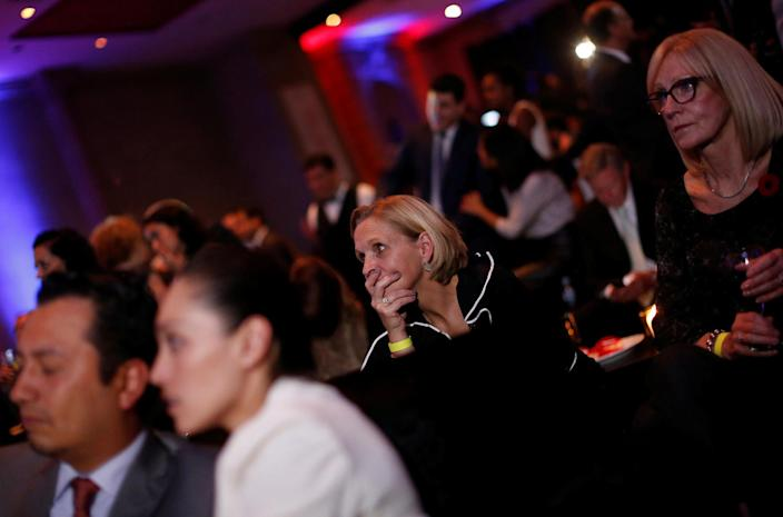 <p>A woman watches a broadcast of the U.S. presidential race between Democratic nominee Hillary Clinton and Republican nominee Donald Trump in a restaurant in Mexico City, Mexico Nov. 8, 2016. (Photo: Carlos Jasso/Reuters) </p>