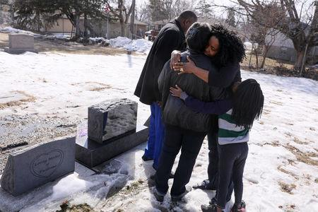 Liberian immigrant Harrietta Bettie visits her family gravesite at Mound Cemetery, which dates to 1862 but now also makes room for the graves of African and Asian immigrants, in Brooklyn Center, Minnesota, U.S., March 23, 2019. REUTERS/Jonathan Ernst