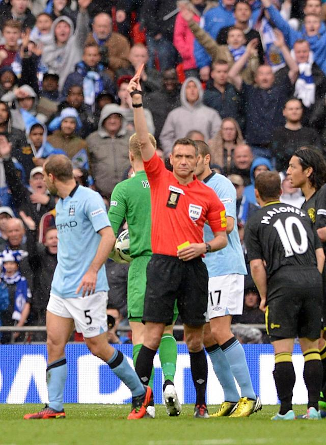 Manchester City's Pablo Zabaleta (left) is sent off by referee Andre Marriner, for a second bookeable offence, following a challenge on Wigan Athletic's Callum McManaman