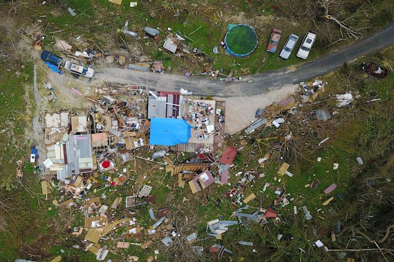 A house destroyed by hurricane winds is seen in Corozal, west of San Juan, Puerto Rico, on Sept. 24 following the passage of Hurricane Maria.