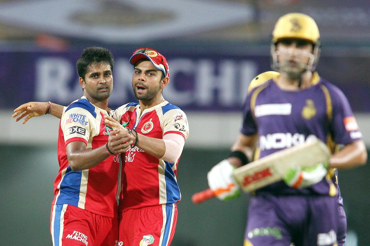Vinay Kumar of the Royal Challengers Bangalore is congratulated by Royal Challengers Bangalore captain Virat Kohli for getting Kolkata Knight Riders captain Gautam Gambhir wicket during match 60 of the Pepsi Indian Premier League between The Kolkata Knight Riders and the Royal Challengers Bangalore held at the JSCA International Stadium Complex, Ranchi, India on the 12th May 2013. (BCCI)