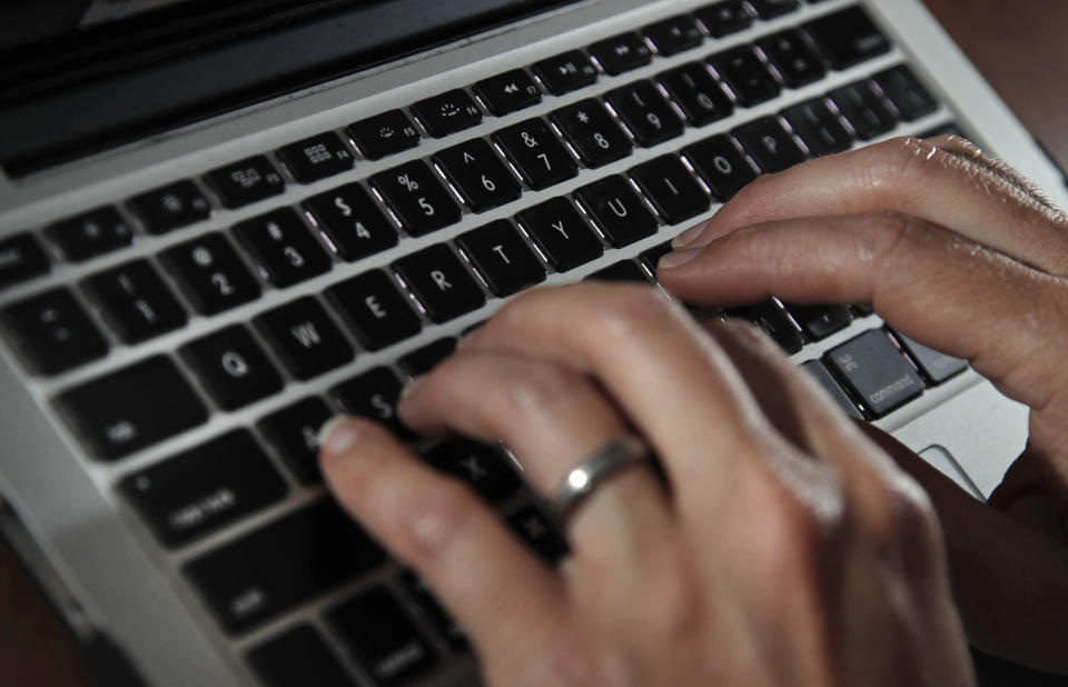 FILE- In this June 19, 2017, file photo, a person types on a laptop keyboard in North Andover, Mass. A new report by a global media consortium that expands the known target list of the Israeli hacker-for-hire firm NSO Group's military-grade spyware provoked alarm Monday, July 19, 2021, among human rights and press freedom activists. They decried the near-complete absence of regulation of commercial surveillance tools. (AP Photo/Elise Amendola, File)
