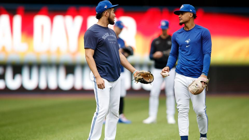Breyvic Valera, left, and Santiago Espinal of the Toronto Blue Jays warm up ahead of their MLB game against the New York Yankees at Rogers Centre on September 30, 2021 in Toronto, Ontario. (Photo by Cole Burston/Getty Images)