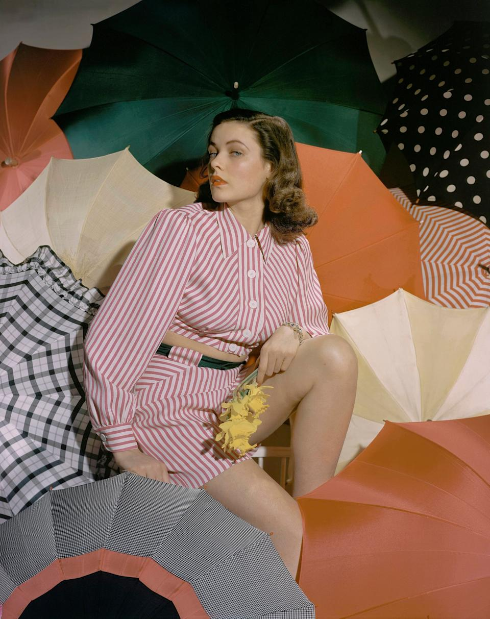 Actress Gene Tierney poses with colorful umbrellas in this undated photo.