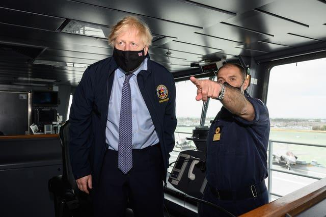 PBoris Johnson speaking with a member of the bridge crew onboard the aircraft carrier