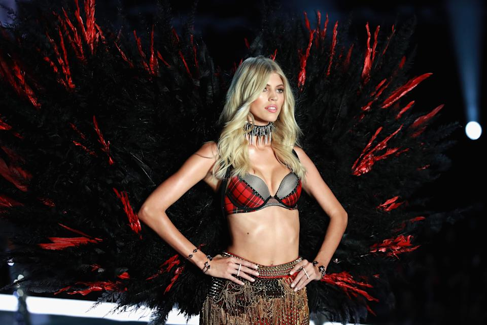 Model Devon Windsor walks the runway for the Victoria's Secret Fashion Show wearing a bra from the Victoria's Secret x Balmain collection. (Photo: Lintao Zhang/Getty Images for Swarovski)