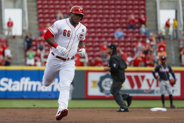 Cincinnati Reds' Yasiel Puig runs the bases after hitting a two-run home run off Atlanta Braves starting pitcher Kevin Gausman in the first inning of a baseball game, Tuesday, April 23, 2019, in Cincinnati. (AP Photo/John Minchillo)