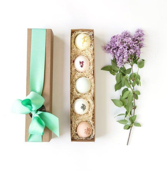 """<p><strong>LittleFlowerSoapCo</strong></p><p>etsy.com</p><p><strong>$15.00</strong></p><p><a href=""""https://go.redirectingat.com?id=74968X1596630&url=https%3A%2F%2Fwww.etsy.com%2Flisting%2F690636055%2Feaster-gift-easter-gifts-easter&sref=https%3A%2F%2Fwww.oprahdaily.com%2Flife%2Fg35448928%2Feaster-basket-gifts%2F"""" rel=""""nofollow noopener"""" target=""""_blank"""" data-ylk=""""slk:SHOP NOW"""" class=""""link rapid-noclick-resp"""">SHOP NOW</a></p><p>For adults, the gift of relaxation in the form of these floral-embellished bath bombs is a much-appreciated basket filler. </p>"""