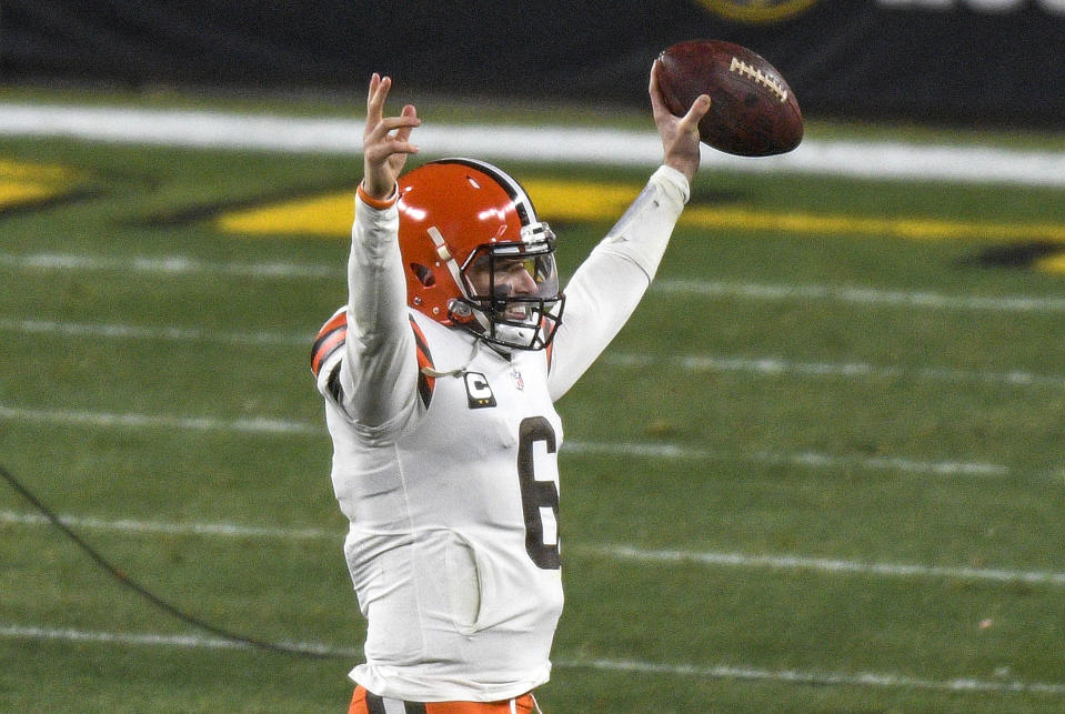 Cleveland Browns quarterback Baker Mayfield (6) celebrates as he walks off the field following a win over the Pittsburgh Steelers in an NFL wild-card playoff football game in Pittsburgh, Sunday, Jan. 10, 2021. (AP Photo/Don Wright)