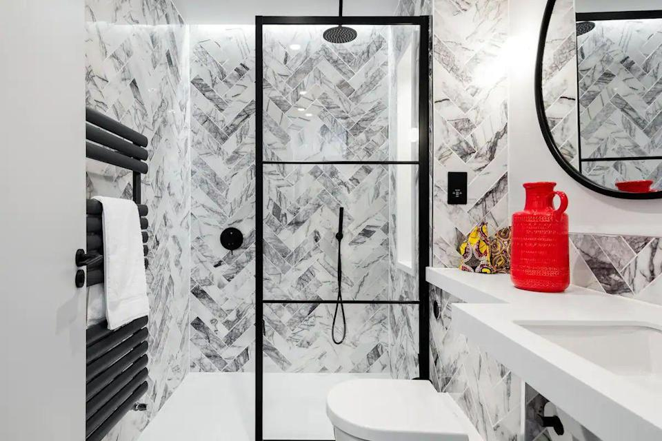 """<p>In this arty loft near Brick Lane, you can start the day under a rain shower in the striking tiled black-and-white bathroom before you stride across the warm timber floors for breakfast in the open-plan kitchen and living area. We love the contemporary artworks that reflect the cool neighbourhood and the Juliet balcony for watching the world go by.</p><p><strong>Sleeps: </strong>Three</p><p><strong>Price per night:</strong> £163.00</p><p><a class=""""link rapid-noclick-resp"""" href=""""https://airbnb.pvxt.net/yRZjG3"""" rel=""""nofollow noopener"""" target=""""_blank"""" data-ylk=""""slk:SEE INSIDE"""">SEE INSIDE</a></p>"""