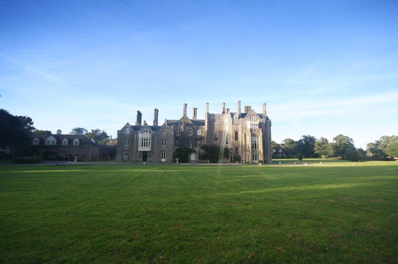 View across parkland to the enormous house
