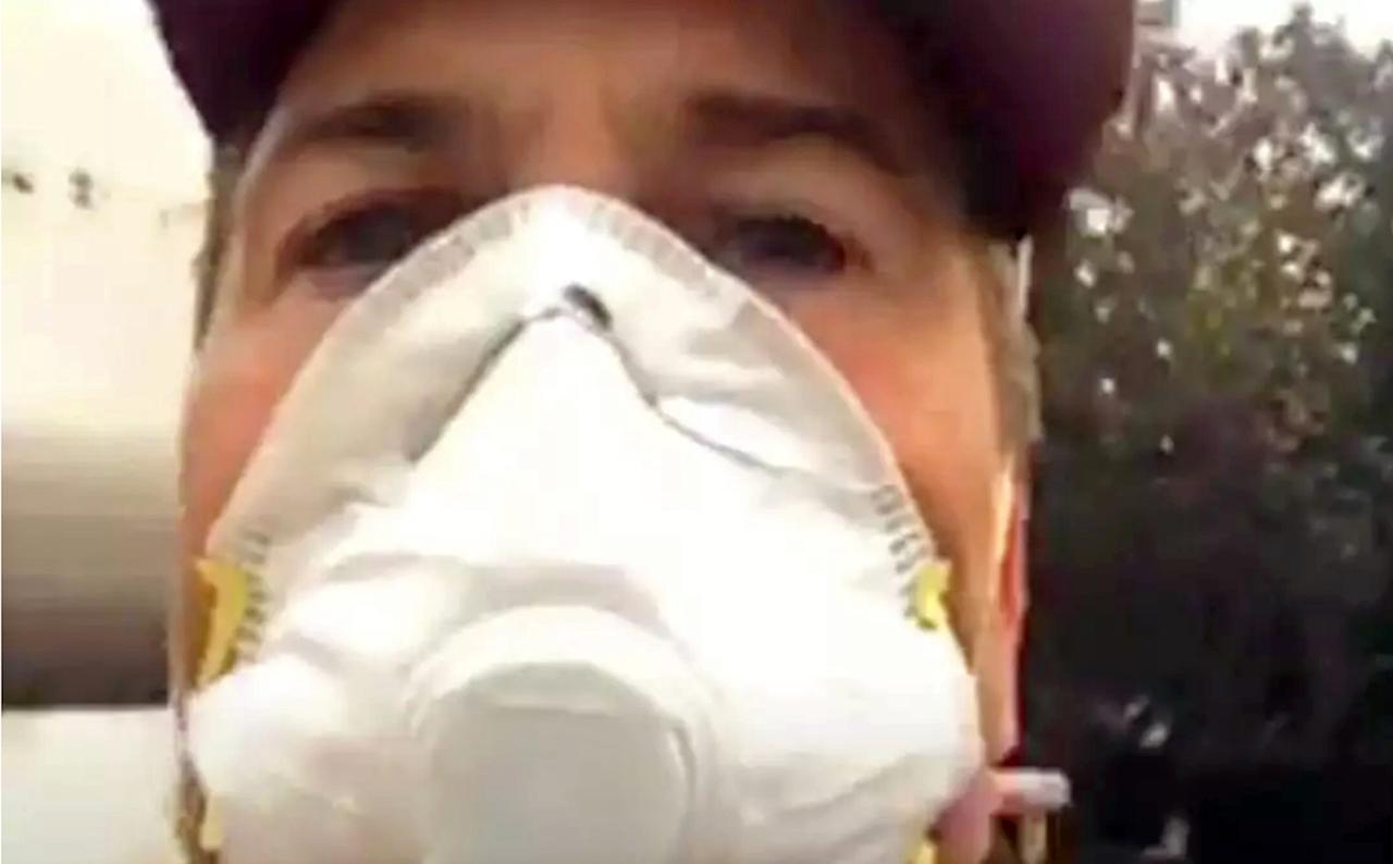 "This Sunday, Dec. 10, 2017, image made from a video on Rob Lowe's Instagram account shows the actor in a mask as he live-streams his family evacuating from their smoke-shrouded home, where a growing Southern California wildfire is threatening homes in the wealthy enclave of Montecito. ""Praying for the people in my area,"" Lowe said to his Instagram followers. ""Hope everybody's getting out safe like we are, and thanks for the prayers and thoughts. And good luck to the firefighters, we need you!"" (Rob Lowe/Instagram via AP)"