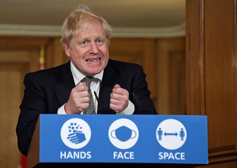 Britain's Prime Minister Boris Johnson gestures as he speaks during a press conference where he is expected to announce new restrictions to help combat the coronavirus disease (COVID-19) outbreak, at 10 Downing Street in London, Britain October 31, 2020. Alberto Pezzali/Pool via REUTERS