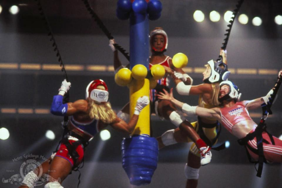 """Do you vaguely remember people balancing on platforms and trying to knock one another off with long foam-covered poles? Then you're picturing the right show. <i>American Gladiators</i> aired from 1989 to 1996 and involved contestants facing off against each other and the show's resident """"Gladiators"""" (who had stage names like Nitro, Sabre, and Turbo) in a series of stunts in order to win money. The Gladiators' costumes in particular are really <a href=""""https://bestlifeonline.com/90s-trivia/?utm_source=yahoo-news&utm_medium=feed&utm_campaign=yahoo-feed"""" rel=""""nofollow noopener"""" target=""""_blank"""" data-ylk=""""slk:a blast from the past"""" class=""""link rapid-noclick-resp"""">a blast from the past</a>. There was an attempt to recapture the magic in 2008, but the <a href=""""https://www.imdb.com/title/tt1092447/"""" rel=""""nofollow noopener"""" target=""""_blank"""" data-ylk=""""slk:reboot"""" class=""""link rapid-noclick-resp"""">reboot</a> only lasted two seasons."""