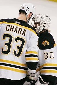 Zdeno Chara and Tim Thomas put their heads together for a victory in Tampa