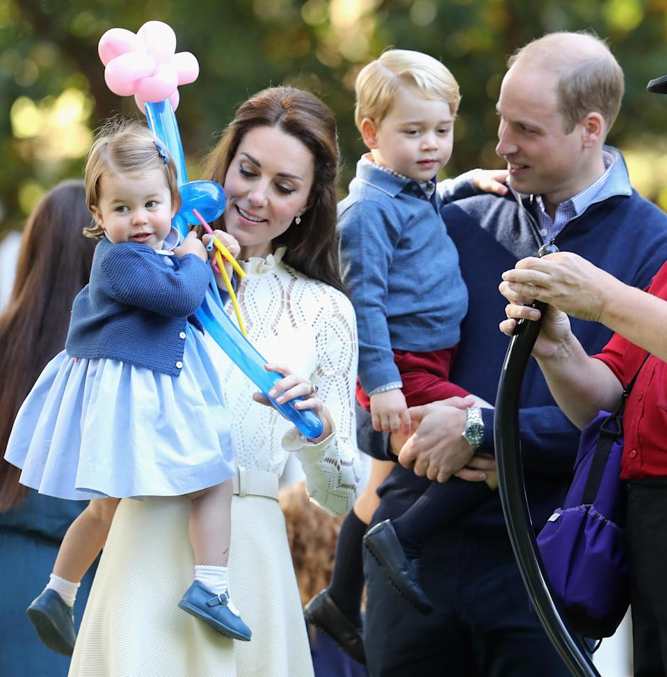 Kate, William, Princess Charlotte and Prince George at a children's party on the royal tour of Canada in 2016 [Photo: Getty]