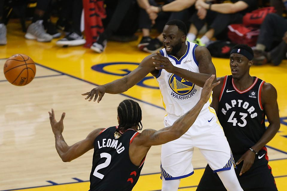 Draymond Green #23 of the Golden State Warriors attempts a pass against the Toronto Raptors in the first halfduring Game Three of the 2019 NBA Finals at ORACLE Arena on June 05, 2019 in Oakland, California. (Photo by Lachlan Cunningham/Getty Images)