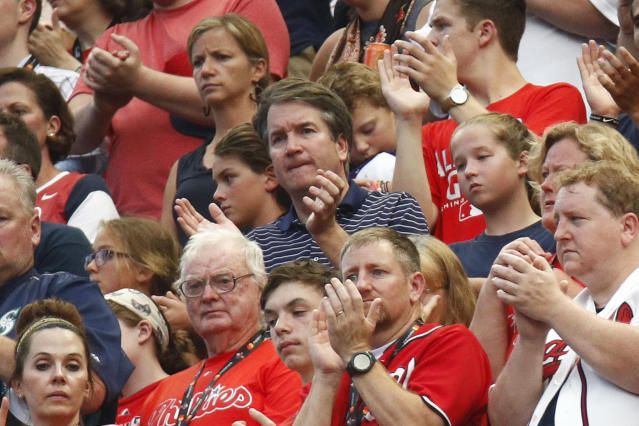 CORRECTS SPELLING TO KAVANAUGH, INSTEAD OF KAVANUAGH - Supreme Court nominee Brett Kavanaugh, center, watches events on the field from the stands before the Major League Baseball All-Star Game, Tuesday, July 17, 2018, in Washington.(AP Photo/Patrick Semansky)
