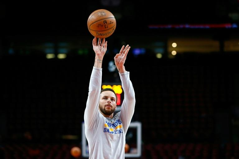 Stephen Curry of the Golden State Warriors warms up prior to their game against the Portland Trail Blazers, at Moda Center in Portland, Oregon, on April 24, 2017