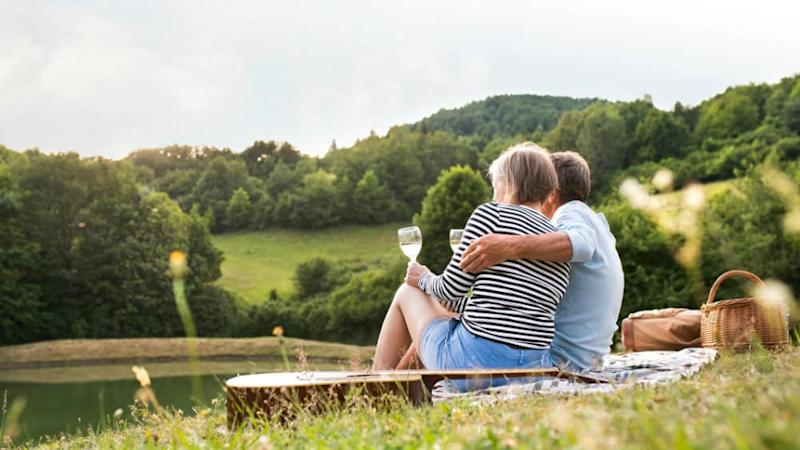 Senior couple at the lake having a picnic