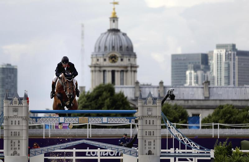 Nick Skelton, of Great Britain, rides his horse Big Star, during a jump-off in the equestrian show jumping team competition at the 2012 Summer Olympics, Monday, Aug. 6, 2012, in London. (AP Photo/David Goldman)