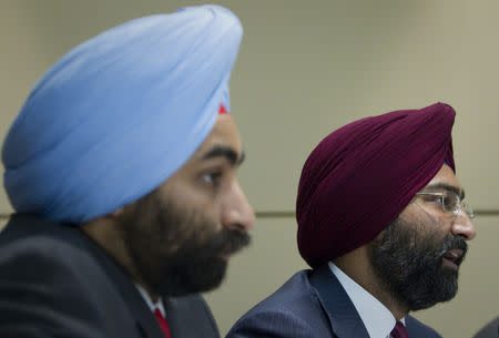 FILE PHOTO: Chairman of Fortis Healthcare Malivnder Singh (R) answers a question as his brother and Managing Director Shivinder Singh sits next to him during a news conference in Singapore July 1, 2010. REUTERS/Vivek Prakash