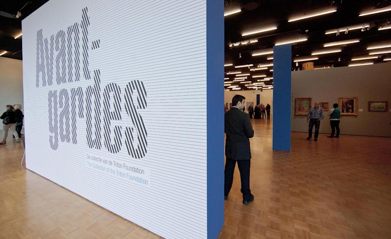 A security guard stands next to the sign of the Avant-gardes exhibit at Kunsthal museum in Rotterdam, Wednesday Oct. 17, 2012. Police investigating a multimillion euro (dollar) art heist of seven painting belonging to the private Triton Foundation say they are following up several tips from the public, a day after thieves grabbed them from the walls of a Rotterdam gallery and vanished into the night. A spokeswoman for detectives on the case, Willemieke Romijn, said Wednesday they have some 15 tips from the public, following a late-night, nationally televised appeal for witnesses to the theft from the Kunsthal gallery of works by celebrated artists including Pablo Picasso, Claude Monet and Henri Matisse. (AP Photo/Peter Dejong)