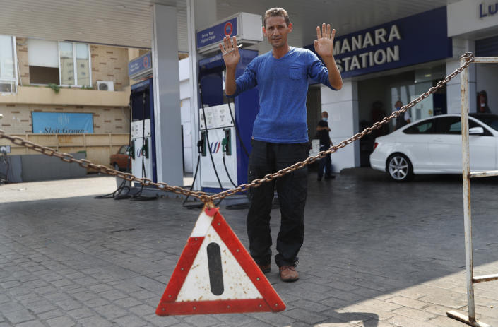 A gas station workers gestures as he saying no fuel at the station, in Beirut, Lebanon, Wednesday, July 29, 2020. Lebanon is hurtling toward a tipping point at an alarming speed, driven by financial ruin, collapsing institutions, hyperinflation and rapidly rising poverty _ with a pandemic on top of that. The collapse threatens to break a nation seen as a model of diversity and resilience in the Arab world. (AP Photo/Hussein Malla)