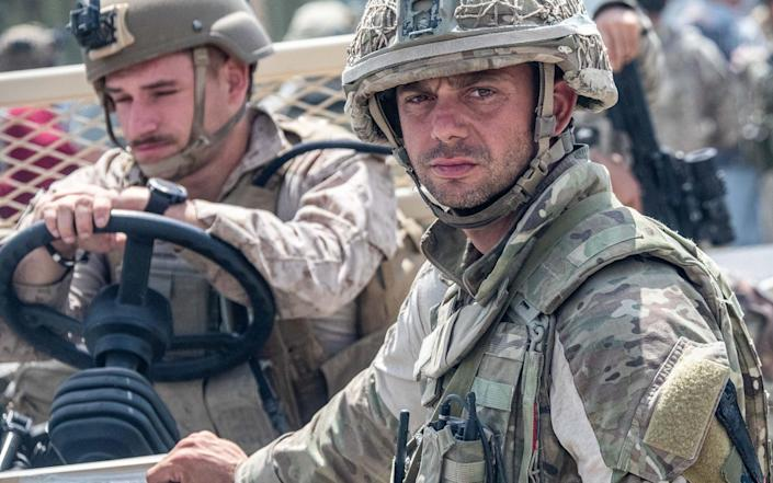 UK and US forces working together on the ground in Kabul - Crown Copyright
