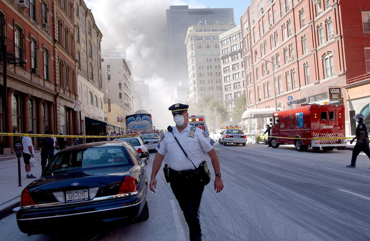 NEW YORK, NY - FILE:   A police officer patrols in the street after the collapse of the World Trade Center towers September 11, 2001 in New York City after two airplanes slammed into the twin towers in a suspected terrorist attack. U.S. President Barack Obama announced the death of Osama Bin Laden during a late evening statement to the press May 1, 2011 in the East Room of the White House. Bin Laden has reportedly been killed near Islamabad, Pakistan, almost a decade after the terrorist attacks of September 11, 2001 and his body is in possession of the United States.(Photo by Spencer Platt/Getty Images)