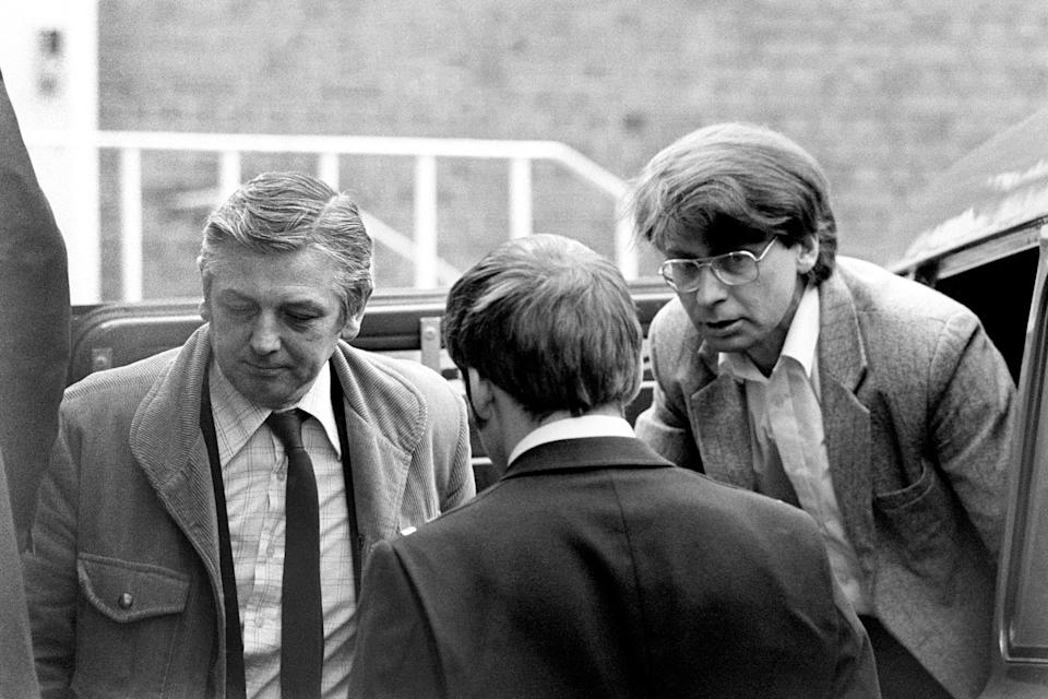 Civil Servant Dennis Nilsen, right, charged with murdering fifteen men, arrives at Highgate Magistrates Court.