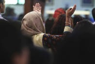 In this Sunday, Jan. 20, 2019 photo, a woman prays during Mass at St. Mary's Catholic Church in Dubai, United Arab Emirates. The Catholic Church's parishioners in the UAE come from around the world and will offer an international welcome to Pope Francis Feb. 3 through Feb. 5, that marks the first ever papal visit to the Arabian Peninsula, the birthplace of Islam. The Catholic Church believes there are some 1 million Catholics in the UAE today. (AP Photo/Jon Gambrell)