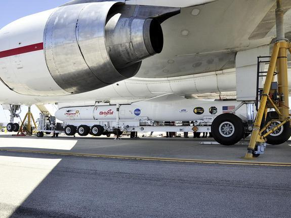 This image shows technicians and engineers at Vandenberg Air Force Base in California connecting the Pegasus XL rocket with the Interface Region Imaging Spectrograph, or IRIS, solar observatory to the Orbital Sciences L-1011 carrier aircraft.