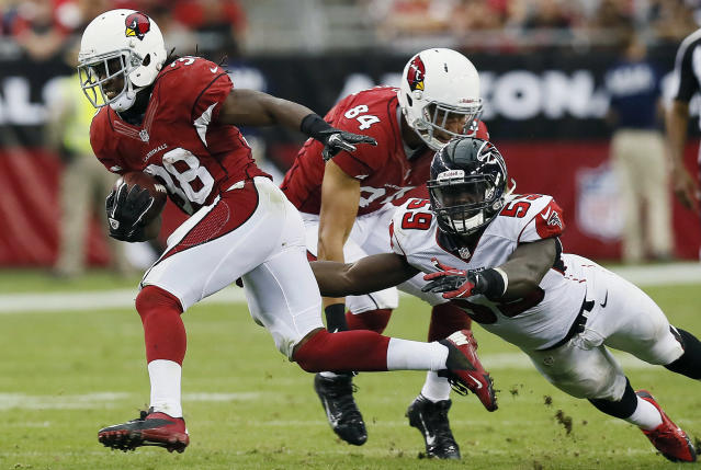 Arizona Cardinals' Andre Ellington, left, gets past Atlanta Falcons' Joplo Bartu (59) as Cardinals' Rob Housler blocks during the second half of an NFL football game on Sunday, Oct. 27, 2013, in Glendale, Ariz. The Cardinals won 27-13. (AP Photo/Ross D. Franklin)