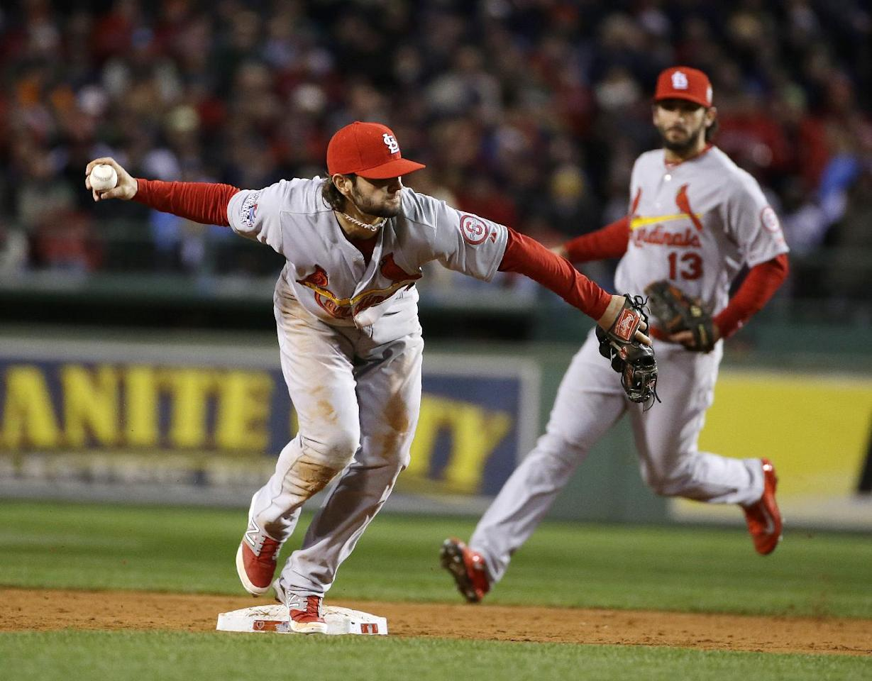 St. Louis Cardinals' Pete Kozma throws out Boston Red Sox's Stephen Drew at first during the seventh inning of Game 2 of baseball's World Series Thursday, Oct. 24, 2013, in Boston. (AP Photo/Matt Slocum)