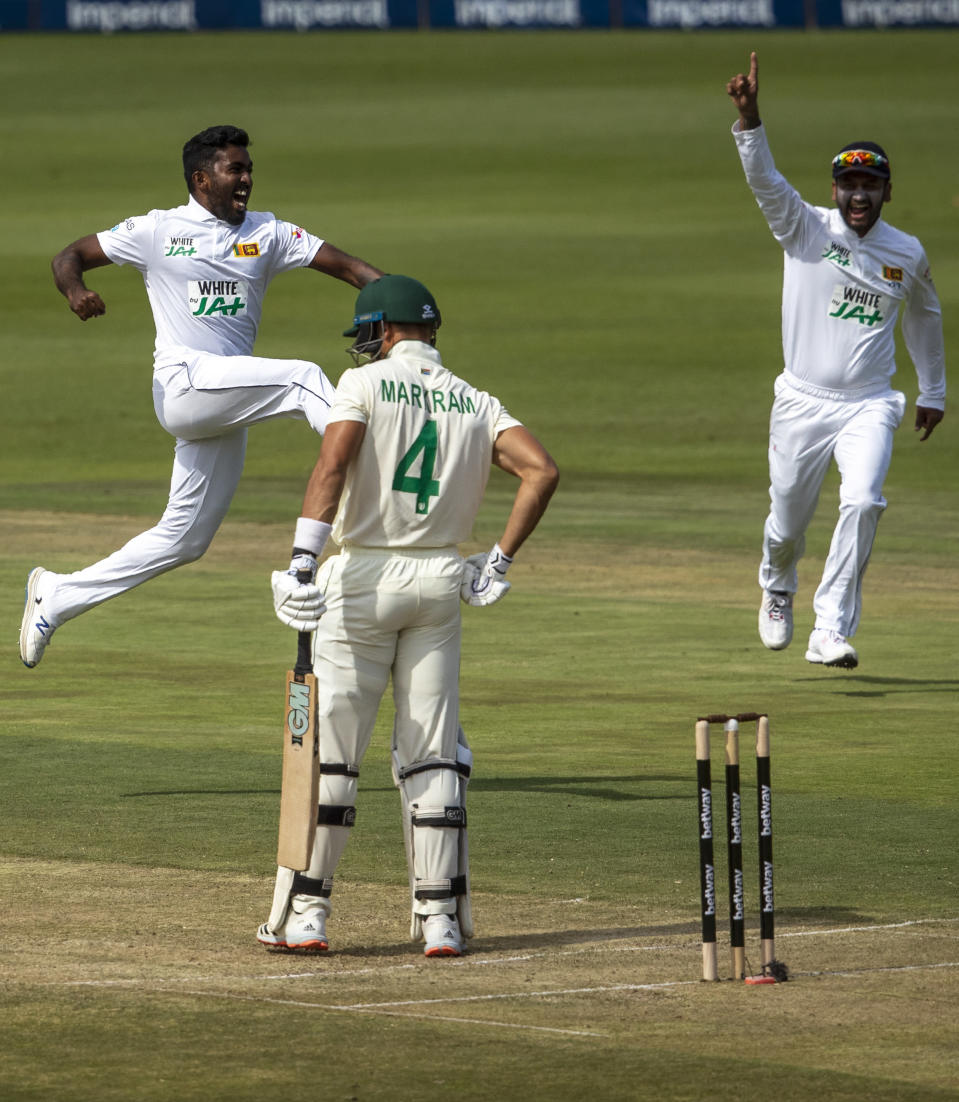 Sri Lanka's bowler Asitha Fernando, left, jumps to celebrate his dismissal of South Africa's batsman Aiden Markram, middle, for 5 runs during the 2nd Test cricket match between South Africa and Sri Lanka Wanderers stadium in Johannesburg, South Africa, Sunday, Jan. 3, 2021. (AP Photo/Themba Hadebe)