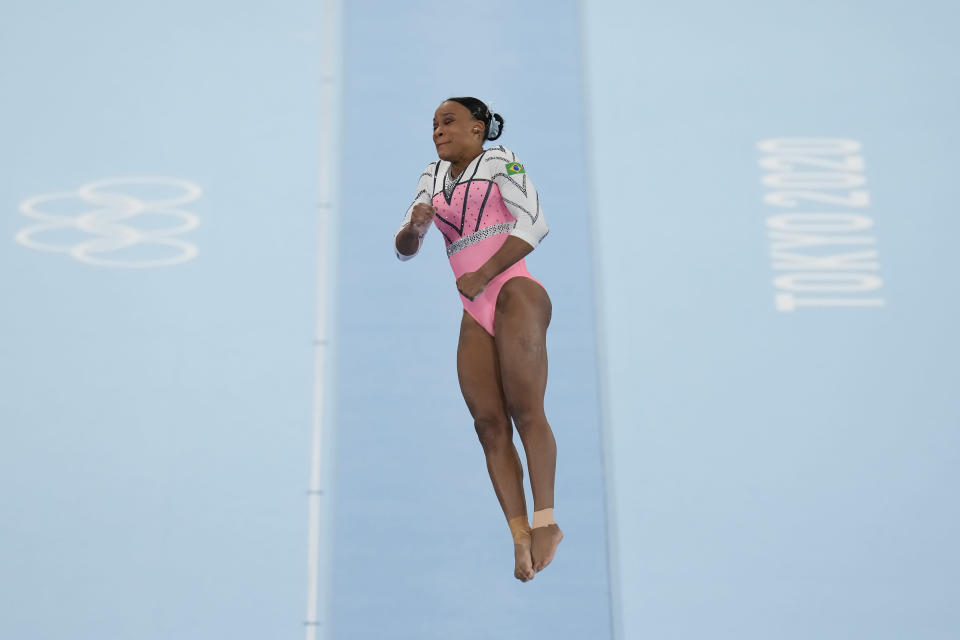 Rebeca Andrade of Brazil, performs on the vault during the artistic gymnastics women's apparatus final at the 2020 Summer Olympics, Sunday, Aug. 1, 2021, in Tokyo, Japan. (AP Photo/Gregory Bull)