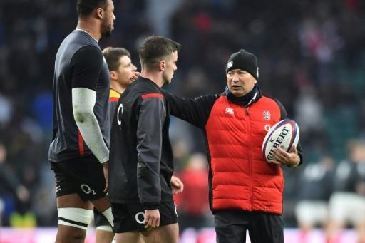 England's coach Eddie Jones (R) takes part in the warm up for the Six Nations international rugby union match between England and Wales at the Twickenham, west London, on February 10, 2018