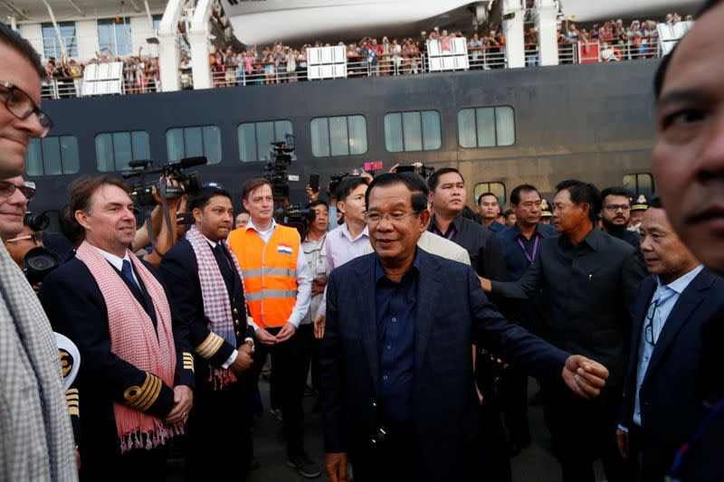 Cambodia's Prime Minister Hun Sen welcomes crews of MS Westerdam, a cruise ship that spent two weeks at sea after being turned away by five countries over fears that someone aboard might have the coronavirus , as it docks in Sihanoukvil