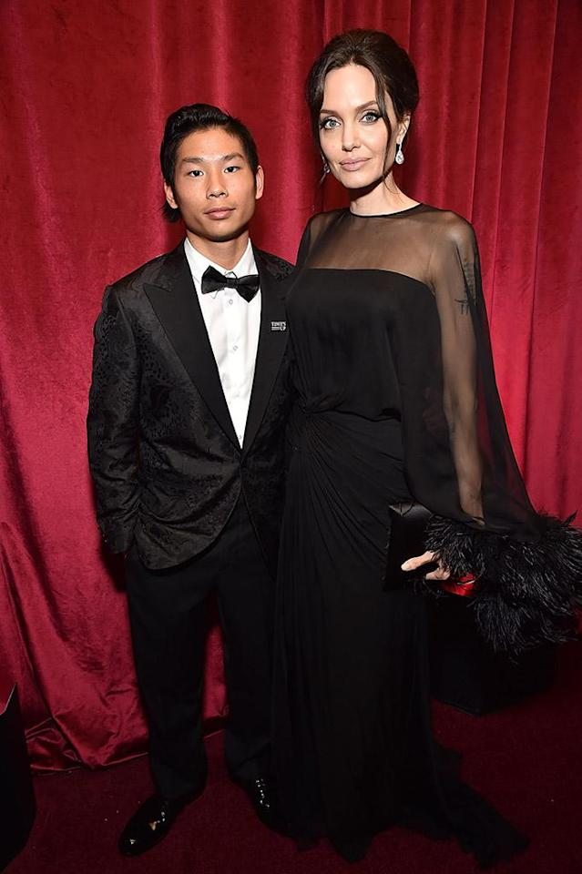 <p>Pax Jolie-Pitt and Angelina Jolie attend the Netflix Golden Globes after-party at the Waldorf Astoria Beverly Hills. (Photo: Kevin Mazur/Getty Images for Netflix) </p>