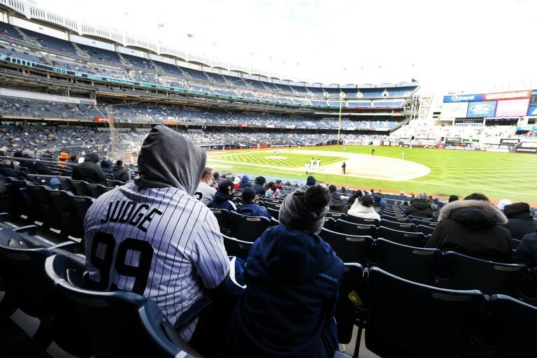 New York Yankees fans watch their team suffer a 3-2 opening day defeat to the Toronto Blue Jays as the 2021 Major League Baseball season gets under way